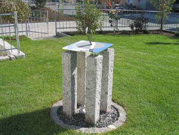 Stainless sundial in a garden in Germany