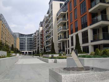 The sundial marks the transition between the concourse of the housing development and the park which is an integral part of the development