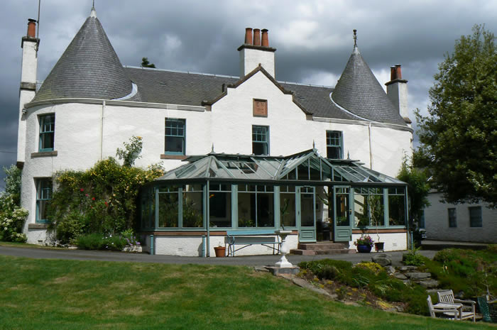 A turreted house in Scotland with its sundial