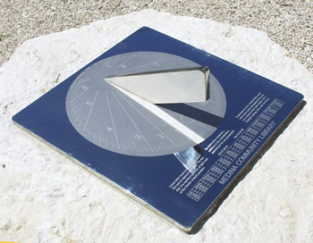 engraving on a Texas sundial